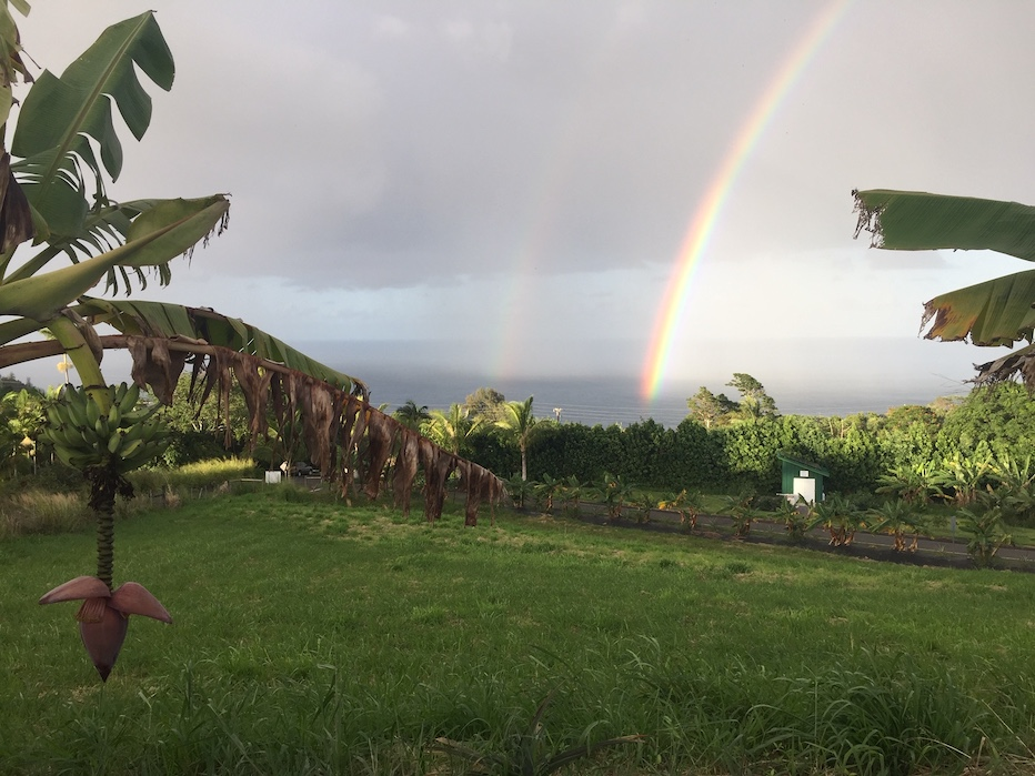 Rainbow over the ocean, a view from the Kuwili Lani property at the beginning of twilight hour